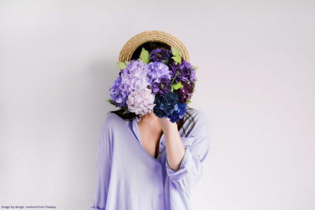 hydrangea hiding womans face